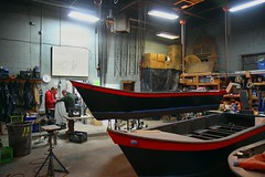 Guest boats with Mike and Elvis working on an electric motor
