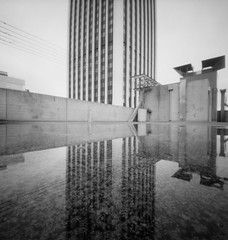 All pieces of the same puzzle (Zeb Andrews) Tags: city urban bw reflection building film oregon analog skyscraper square portland puddle cityscape parkinggarage geometry pinhole pacificnorthwest pdx wellsfargo zero2000 zeroimage zeroimagepinhole shadesofgray zeroimage2000 bluemooncamera