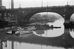 [Boats and barge under the Georgia Viaduct]