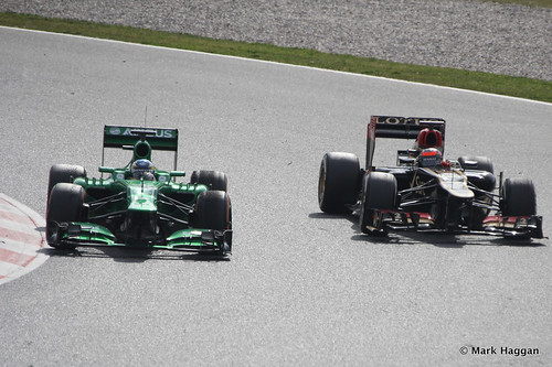 Charles Pic in his Caterham and Kimi Raikkonen in his Lotus at Formula One Winter Testing 2013