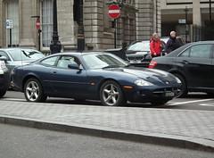 Jaguar XK8 (kenjonbro) Tags: uk blue england westminster trafalgarsquare jaguar coupe charingcross guernsey sw1 xk gbg xk8 19906 worldcars kenjonbro fujifilmfinepixhs10