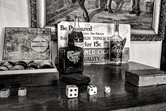 Games of Skill and Chance (Scosanf) Tags: artifacts historic mining old antiques nostalgic blackandwhite bw monochrome dice billiards pokerchips grainy bokeh sign painting glassbottles drinks bar wood museum travel trip vacation summer colorado montrose canon eos ef2470mmf28lusm 6d