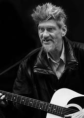 Street musician (D80_455628) (Itzick) Tags: denmark copenhagen blackbackground guitar music candid man face bw d800 itzick streetperformer teeth