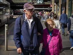The Windy City (Leanne Boulton) Tags: urban street candid portrait portraiture groupshot streetphotography candidstreetphotography candidportrait streetlife elderly old age aged man male woman female couple love romance together relationship bright pink blue face faces facial expression tone texture detail depth natural outdoor sunlight light shade shadow city scene human life living humanity people society culture canon 7d color colour glasgow scotland uk