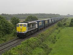 085 on Waterford-Ballina Norfolk liner near Kilberry 20-Jul-07 (metrovick) Tags: irishrail iarnrodeireann ie071class ie085 norfolkline containertrain freighttrain railroad railway railwaykildare kilberry emd emdexportloco jt22cw