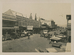 Gouger Street (City of Adelaide) Tags: adelaide cityofadelaide cityofadelaideciviccollection gougerstreet charlesmoores blacksltd peoplestoreslimited storefronts townacre378 townacre379 townacre380 cars bicycles pedestrians shoppers samuelwaybuilding