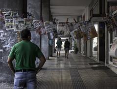 Hanged news (Kostis Tatakis) Tags: street streetphotography candid outdoors city citylife passage newspaper newspapers hanged man standing athens greece nikon nikond nikond80