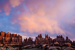 Red Rocks, Red Sky (Ralph Earlandson) Tags: canyonlands needles sunset utah dailyrayofhope2013 landscape desert coloradoplateau droh clouds
