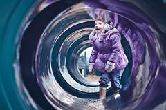Tubular (Mr:Mac) Tags: blue winter cold reflection girl playground fun 50mm kid nikon child play purple candid tube tunnel d7000