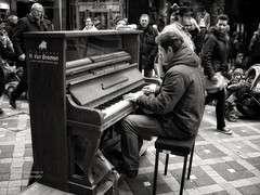 The young pianist (Le Xuan-Cung) Tags: winter people urban blackandwhite bw sun sunlight men portraits daylight lightsandshadows nikon women mood alone child faces noiretblanc walk dream citylife streetshots streetphotography atmosphere streetlife streetscene nb sidewalk thoughts nrw sw noon drama dortmund bigcity sunnyday urbanshots livingingermany lightsanddarks characterstudies nikoncoolpixs52 livingindortmund urbandortmund theyoungpianist livinginnrw inthecolddays