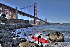 Surfing under the Bridge (papalars) Tags: sanfrancisco sunset red cold water surf waves dusk smooth surfing goldengatebridge goldengate sanfran wetsuit redboard wintersurfing papalars silkeffect gentlesun gentlesky andrewlarsenphotography