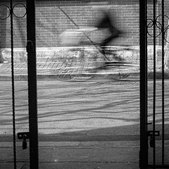 assaulted by geometry (~mimo~) Tags: china street door blackandwhite motion blur bike bicycle metal circle square photography triangle gate asia shanghai geometry passing mimokhair becauselifeneverstopsmoving
