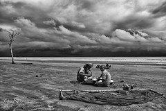 Life in the storm (Neerod [ www.colorandlightphotography.com ]) Tags: wild storm bay fishing lonely bengal bangladesh lonelytree prawn postlarvae kuakata
