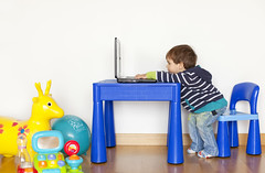 Small boy in front of a laptop (Nasos Zovoilis) Tags: background beautiful black boy bright business caucasian cheerful child childhood color communication computer cute desk education enjoying expression eyes fun game happy home house human indoor internet isolated joy joyful keyboard kid laptop learn learning leisure life lifestyle light little living looking male modern notebook one pc people person phone play playing portrait preteen red school schoolboy service sit sitting small smile student success surfing table technology using watching web white wireless work young youth
