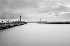 Whitby Twin Towers (Iamamanc) Tags: longexposure lighthouse clouds cloudy harbour whitby twintowers stonewall ta captaincook stonebuilt tamron1750mmf28 adrianfortuneskycom