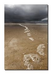 Beach bubbles (Simon Bone Photography) Tags: sea seascape beach coast sand cornwall tide shoreline bubbles cliffs coastal coastline darksky gwithian beachscape tideline moodysky godrevybeach canoneos5dmkii wwwsimonbonephotographycouk canonef24105mmislf4
