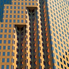 In the City of the Blasted Sun (Bad Kicker) Tags: city windows urban abstract building geometric lines vertical architecture pattern towers abstarct