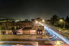 rainy night (Zesk MF) Tags: trier rain regen longtime langzeit stitch autos car street lights trails crossing kreuzung city night zesk nikon 8mm