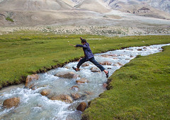 Wakhi boy jumping over a river in pamir mountains, Big pamir, Wakhan, Afghanistan (Eric Lafforgue) Tags: 1617years action afghan afghan274 afghani afghanistan altitude badakhshan bigpamir centralasia colourimage community crossing cultures day fullframe grass horizontal ismaili jumping landscape males mountain nature nomad nomadicpeople oneperson outdoors pamirmountains people photography river rock scenery teenageboy teenager tourism traveldestinations unrecognizableperson wakhancorridor wakhi water wakhan pamir