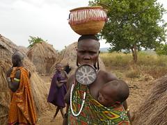 Mursi women and baby (Ethiopia) (davidevarenni) Tags: mursi etiopia ethiopia woman lactating tribe trib
