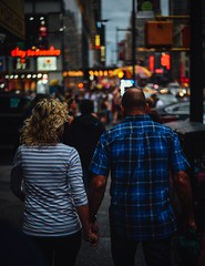 Couple in the City (typray) Tags: walking tones d810 nikon city buildings streets lights travel newyork nyc streetphotography people woman man couple love bokeh