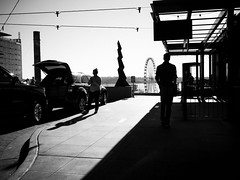 Seattle 2016 (Warfield360) Tags: blackandwhite monochrome seattle street city cityscape urban streetphoto building construction smokestack sculpture ferriswheel cafe people man woman electrictrolleywires sky water pugetsound vehicles newconstruction shadows silhouette pikeplace market