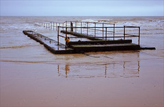 all at sea (Ron Layters) Tags: winter sea england cold reflection beach water geotagged kent sand waves pentax unitedkingdom horizon overcast slide velvia transparency fujichrome railings englishchannel pentaxmz10 dymchurch romneymarsh shepway ronlayters slidefilmthenscanned mz10 geo:lat=5102236234378574 geo:lon=09945864221707201