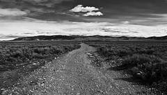 Breathing space (CNorthExplores) Tags: road park travel autumn sky bw usa white black clouds canon open space wide grand national wyoming teton gravel sagebrush breathing g11 explored