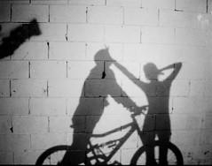 Young Love (vilyviane) Tags: bw white black film me bike self shadows mini diana steven