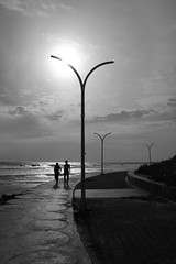 Under The Beach Sun (sightmybyblinded) Tags: lighting sunset two people blackandwhite sun dan beach monochrome canon couple asia noir basket pole lamps 1855mm silhoutte mangan 500d blanck danmangan