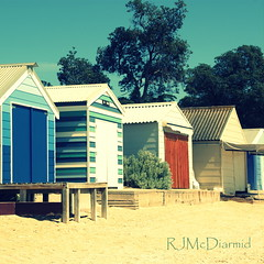 Coloured beach huts (RachaelMc) Tags: travel color building tourism beach water square crossprocessed sand waves seagull australia victoria huts hut changing swimmers coloured morningtonpeninsula treated sheds dromana travelphotography rachaelmc rjmcdiarmid