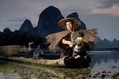 Lost In Time (craigkass) Tags: china mountains liriver fishing fisherman asia guilin yangshuo traditional cormorant karst guangxi cormorantfishing rurallife xingping limestonekarst bestportraitsaoi