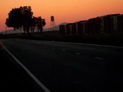 twilight, Port Chicago Highway, Bay Point, April 4, 2009 (/\/\ichael Patric|{) Tags: california road railroad orange tree silhouette northerncalifornia geotagged evening twilight highway dusk railway sanfranciscobayarea bayarea april eastbay sfbayarea dim westcoast 2009 boxcars lanes baypoint contracostacounty michaelpatrick april2009 contracostacountycalifornia address:postalcode=94565 baypointcalifornia geo:lat=380404 geo:lon=1219711 address:street=portchicagohighway