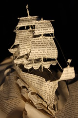 Hull (From Within a Book...) Tags: sculpture detail art water hat altered paper paperart word photography reading book design boat words 3d artwork waves ship flag text details sails craft books photograph captain micro page sail mast rigging sculptor bookart aye emmataylor booksculpture fromwithinabook