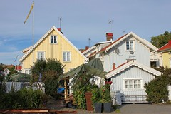 Houses in Grundsund (K Nilsen) Tags: blue houses homes summer plants green yellow facade coast wooden sweden flag cottage roofs coastal tiles sverige flagpole bohusln grundsund skaft summerhomes