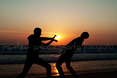 (Irantzu Arbaizagoitia) Tags: ocean travel sunset sea summer vacation two sky people sun holiday man men beach silhouette fun evening play outdoor dusk young happiness shore getty activity curators