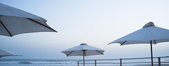 Shades of light - Beach parasols (Keen2C) Tags: red beach waves umbrellas cotedivoire parasols ivorycoast assinie laocean