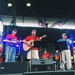 Chancellor Woodson sings with his band at Packapalooza.