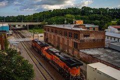 BNSF ES44C4 No. 7137 and No. 8371 lead a intermodal train past the abandoned Northwestern Cabinet Company building located in Burlington, Iowa. (andrew_busse) Tags: andrew busse railroad photography railway trains train iowa midwest summer 2016 august summertime clouds northwestern cabinet company abandoned building intermodal z ups usps container bnsf es44c4 burlington northern santa fe nikon d3200