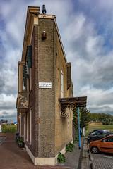 Cutting corners - HWW (Jorden Esser) Tags: nederlandvandaag maassluis balcony cornerhouse cornerwall hww sign smallsidewall wallwednesday flatiron