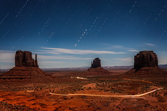 Night time at Monument Valley (danielacon15) Tags: red unitedstates travel outdoors navajotribalpark nature coloradoplateau erosion monumentvalley landscape americansouthwest desert 2016 naturalmonuments utah mesas structures night star trails car lights butte mesa longexposure 500px