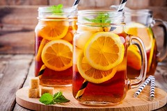 ice tea with slice of lemon in mason jar (frankhfox86) Tags: tea ice drink cold jar lemon mint temperature food glass drinking cube fruit sweet freshness citrus leaf no people cocktail liquid summer slice color alcohol closeup selective water yellow focus juice table straw brown soda drinks wet healthy lemonade rustic wood nonalcoholic icetea frozen beverage gold wooden background pitcher mason