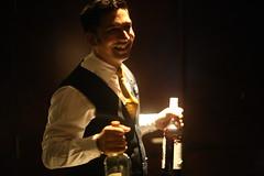 Baptized by the bottles (N A Y E E M) Tags: mahi bartender mohyeddeen candid portrait latenight smile bottles light baikalbar radissonblu hotel chittagong bangladesh sooc raw unedited untouched unposed availablelight indoors atmosphere handheld waistlevel