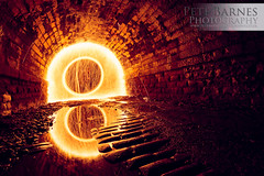 Light at the End of the Tunnel (Pete Barnes Photography) Tags: longexposure light urban orange lightpainting reflection brick eye art wheel dark circle fire photography photographer spin industy orb 8 tunnel ring professional cobble flame sparks eight catherinewheel petebarnes