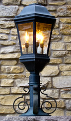 St. Charles Lamp (Jim Frazier) Tags: city urban detail brick lamp yellow stone wall closeup illinois streetlight downtown bright pov may streetscene symmetry il symmetrical lit kanecounty kane perpendicular stcharles centered theoffice 2012 illuminate saintcharles headon businessdistrict q2 centralperspective ldfebruary jimfraziercom wmembed ld2013
