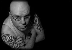 Arms folded. (CWhatPhotos) Tags: pictures blue light shadow portrait fish man male eye art tattoo self canon pose dark hair that lens photography eos focus artist foto shadows looking view image artistic pics body head no manly bald picture down pic images tribal tattoos fisheye have upper photographs photograph fotos 7d slap manual lookingdown emotional tribe tat which contain baldy slaphead inked selfie baldhead tats shadowed tatt tatts 65mm aspherical opteka selfies selfees selfee cwhatphotos