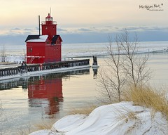 Winter reflections- Holland Harbor Lighthouse (Big Red) (Michigan Nut) Tags: winter sunset sky usa lighthouse snow reflection building ice water landscape harbor pier michigan scenic structure lakemichigan hollandmichigan johnmccormick hollandlighthouse michigannutphotography