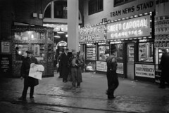 [The Tram News Stand and Coffee Shop illuminated at night in the B.C. Electric Building at 425 Carrall Street]