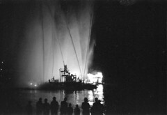 [Fire boat fighting fire at night]