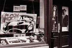Vroom (f_bertrand) Tags: bw film montreal comicbooks storewindow ilford windowshopping jamesdean humphreybogart moviememorabilia ilfordfilm ricohxr10